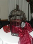 Decorative bird cage for money envelopes on wedding gift table