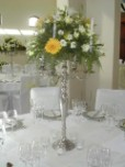 Silver candelabra, flower arrangement as guest table centrepiece