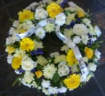 Personalized funeral flowers - round wreath from a Cape Town florist