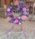 Round personalized wreath on a flower stand - funeral flowers in Cape Town