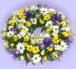 Send a ring-shaped wreath of quality flowers - click to enlarge
