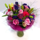 A variety of mixed cut flowers in vibrant colours - click to enlarge